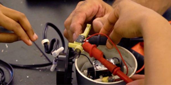 Repair Cafe - hands repairing together
