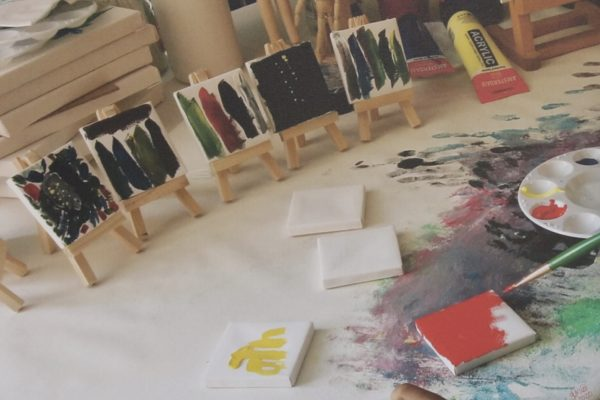 portraits of kids hands making art